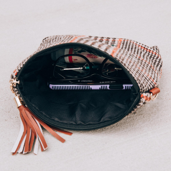 """Houndstooth pouch bag with a zipper closure tassel detail and detachable wristlet.  - Approximately 9"""" W x 6.5"""" H - 100% Polyester"""