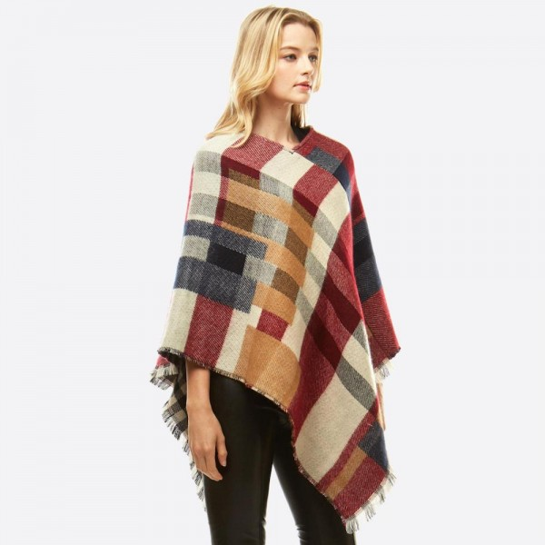 "Multicolor plaid poncho.  - One size fits most 0-14 - Approximately 37"" in length - 100% Acrylic"