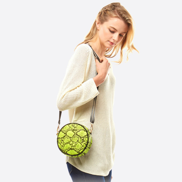 "Round faux leather snakeskin crossbody bag/fanny pack featuring two inside pocket details.  - Approximately 7"" in diameter - 100% PU"