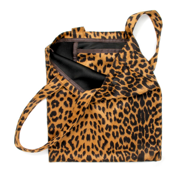 "Leopard print tote bag featuring one inside pocket detail.  - Approximately 13"" W x 14.5"" T - 100% Polyester"