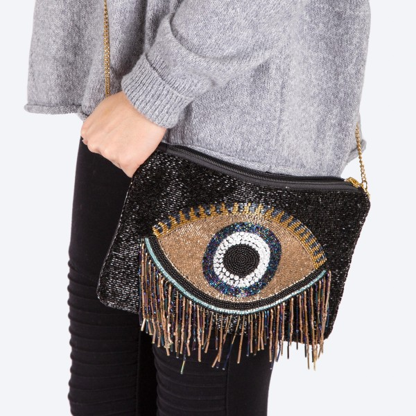 "High quality seed beaded evil eye tassel handbag.  - Zipper closure - One inside open pocket - Inside lining 100% Cotton - Approximately 10.5"" W x 7"" T - Strap approximately 52"" L - Approximately 68"" L overall - 40% Seed beads, 40% Cotton Canvas, 20% Metal"