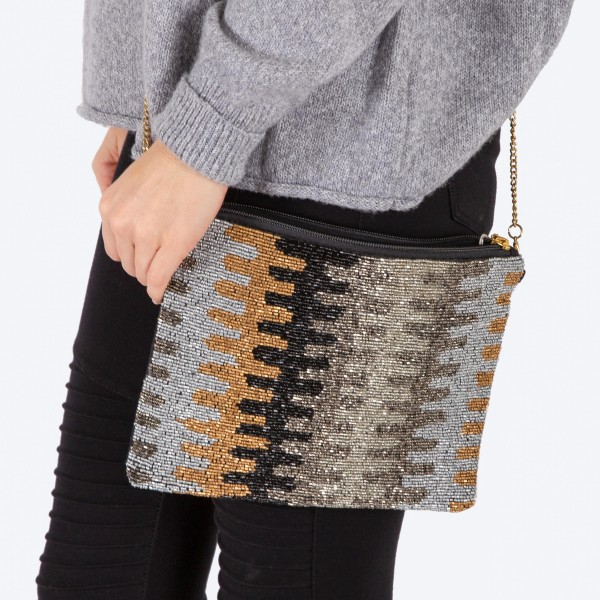 """High quality seed beaded handbag.  - Zipper closure - One inside open pocket - Inside lining 100% Cotton - Approximately 10.5"""" W x 7"""" T - Strap approximately 52"""" L - Approximately 62"""" L overall - 40% Seed beads, 40% Cotton Canvas, 20% Metal"""