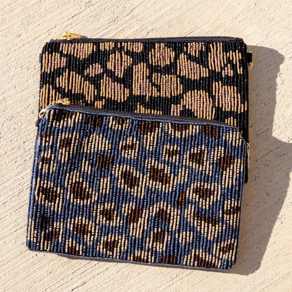 """High quality seed beaded leopard print handbag.  - Zipper closure - One inside open pocket - Inside lining 100% Cotton - Approximately 10.5"""" W x 7"""" T - Strap approximately 52"""" L - Approximately 62"""" L overall - 40% Seed beads, 40% Cotton Canvas, 20% Metal"""