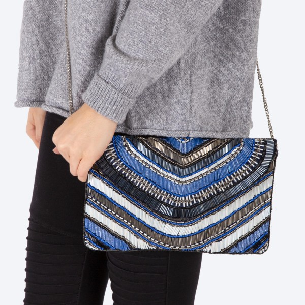 """High quality multicolor stripe seed beaded handbag.  - Fold over snap button closure - One inside open pocket - Inside lining 100% Cotton - Approximately 10.5"""" W x 6"""" T - Strap approximately 52"""" L - Approximately 62"""" L overall - 40% Seed beads, 40% Cotton Canvas, 20% Metal"""