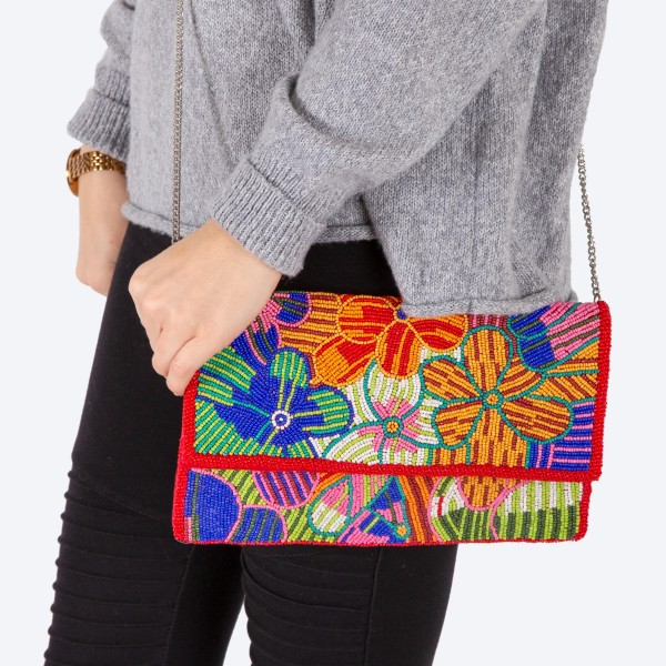 """High quality multicolor seed beaded floral print handbag.  - Fold over snap button closure - One inside open pocket - Inside lining 100% Cotton - Approximately 10.5"""" W x 6"""" T - Strap approximately 52"""" L - Approximately 62"""" L overall - 40% Seed beads, 40% Cotton Canvas, 20% Metal"""