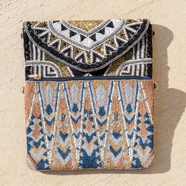 """High quality blue multicolor geometric seed beaded handbag.  - One inside open pocket - Inside lining 100% Cotton - Approximately 10.5"""" W x 7"""" L - Strap approximately 52"""" L - Approximately 62"""" L overall - 40% Seed beads, 40% Cotton Canvas, 20% Metal"""