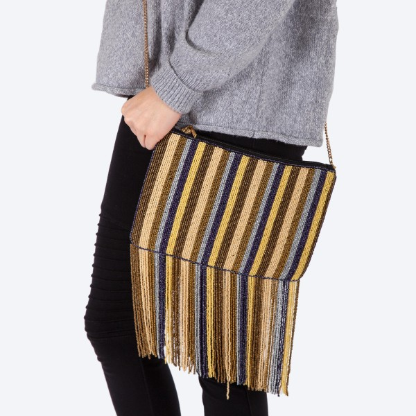 """High quality multicolor stripe seed beaded tassel handbag.  - One inside open pocket - Inside lining 100% Cotton - Approximately 10.5"""" W x 7"""" L - Strap approximately 52"""" L - Approximately 82"""" L overall - 40% Seed beads, 40% Cotton Canvas, 20% Metal"""