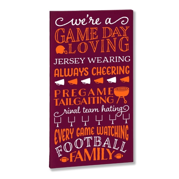 """""""The Game Day Loving"""" canvas is perfect for any football fan. Each canvas comes in your favorite team colors and with a metal hook on the back for hanging. Measures approximately 10"""" x 1.5"""" x 19."""""""