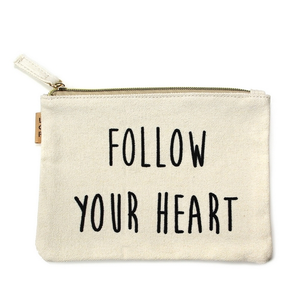 """Canvas zipper pouch with """"Follow Your Heart"""" on the front. 100% cotton. Measures 7"""" x 6"""" in size."""
