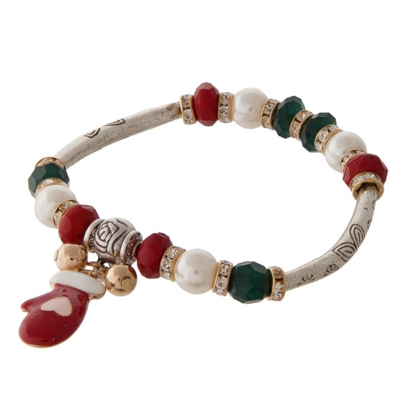 Stretch bracelet with Christmas themed charm.