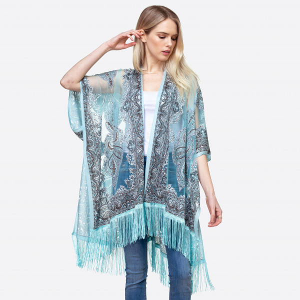 "Lightweight turquoise kimono featuring a paisley geometric inspired pattern with tassel accents. Approximately 36"" in length.   One size fits most 0-14.  Composition: 60% Polyester 40% Viscose."