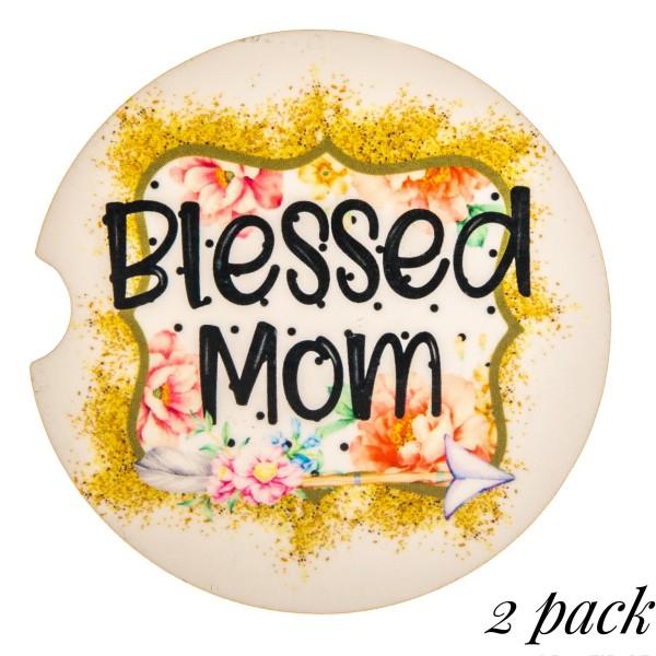 """Blessed Mom"" floral illustration printed car coaster set.   - Pack Breakdown: 2pcs / pack - Approximately 2"" in diameter - Finger slot for easy removal - Condensation absorbing cork"