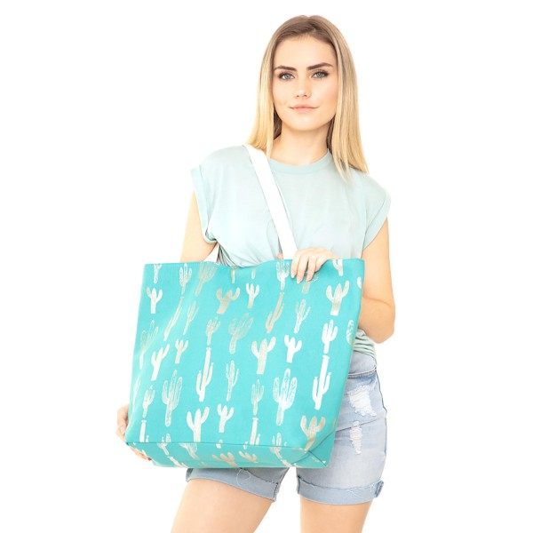 "Metallic cactus canvas beach bag with rope strap details.  - Button closure - One inside open pocket - Approximately 20.5"" W x 16"" T  - Strap length 12"" - 60% Cotton, 40% Polyester"