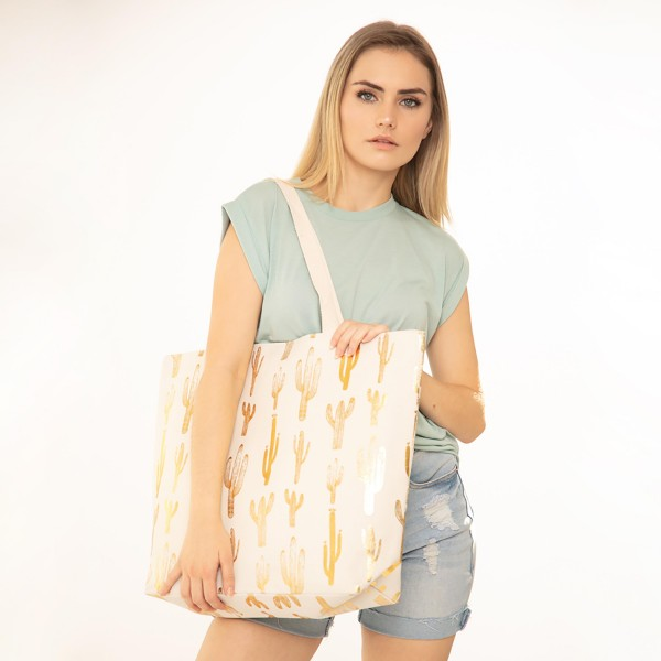 """Metallic cactus canvas beach bag with rope strap details.  - Button closure - One inside open pocket - Approximately 20.5"""" W x 16"""" T  - Strap length 12"""" - 60% Cotton, 40% Polyester"""
