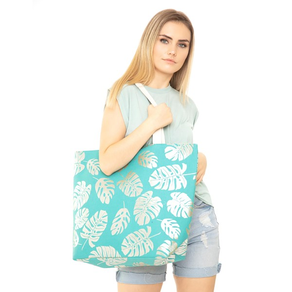"""Metallic palm leaf canvas beach bag with rope strap details.  - Button closure - One inside open pocket - Approximately 20.5"""" W x 16"""" T  - Strap length 12"""" - 60% Cotton, 40% Polyester"""
