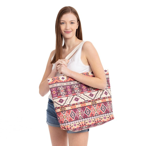 "Aztec print beach bag.  - Button closure - One inside open pocket - Approximately 20.5"" W x 16"" T  - Strap length 12"" - 60% Cotton, 40% Polyester"