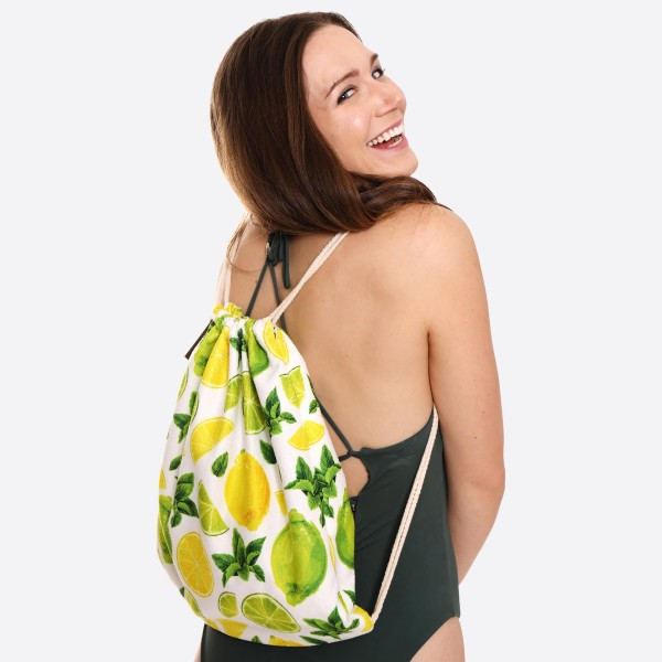"Lemon Lime Beach Towel Drawstring Bag All in One.  - Unfold your bag to use the soft beach towel - Conveniently folds back into a drawstring bag - Towel approximately 27"" W x 59"" L - 70% Cotton / 30% Polyester"
