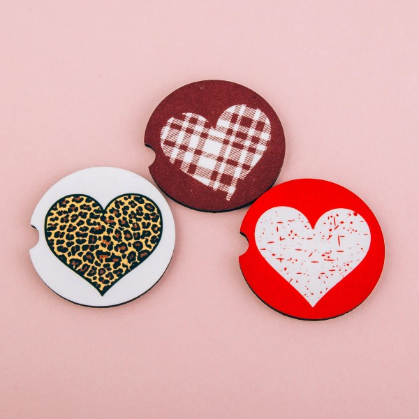 """Leopard heart printed car coaster set.  - Pack Breakdown: 2pcs / pack - Approximately 2"""" in diameter - Finger slot for easy removal - Condensation absorbing cork"""
