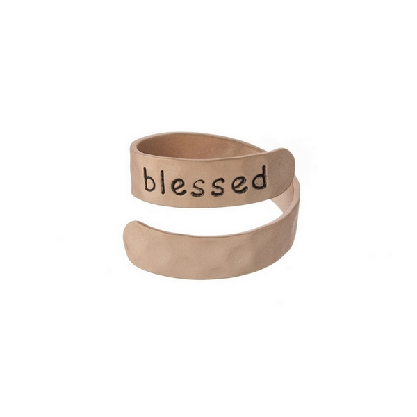 """Hammered copper tone, adjustable ring stamped with """"Believe."""""""