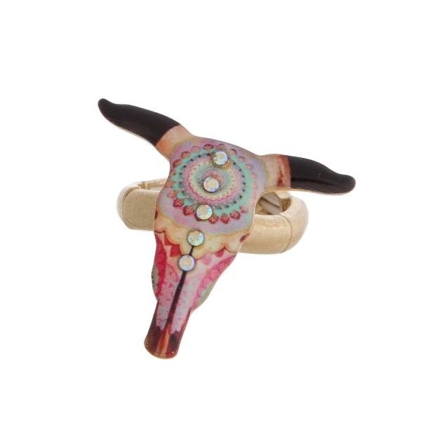 Burnished metal, stretch ring with a steer head focal and aztec pattern.
