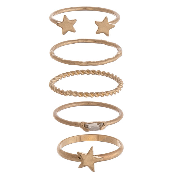Set of 5 complementary gold rings with star accents and textured details. One size fits most.