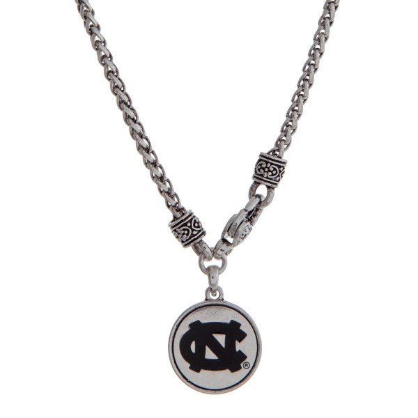 "Officially licensed University of North Carolina silver tone necklace with a front lobster claps and a logo charm. Approximately 18"" in length."