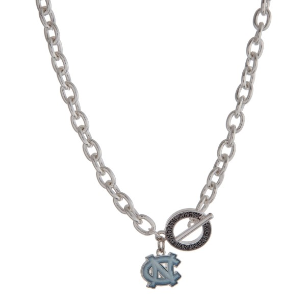 "Silver tone officially licensed University of North Carolina toggle necklace with the logo charm. Approximately 18"" in length."