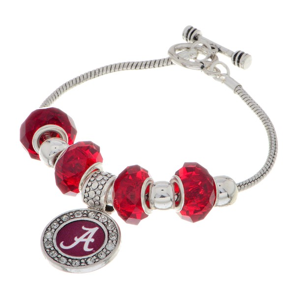 """Officially licensed 7"""" Silver tone toggle closure charm bracelet featuring an Alabama logo charm accented by red and silver tone sliding charms."""