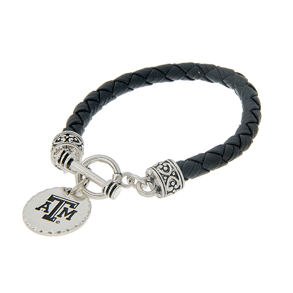 """Black braided faux leather toggle bracelet with an officially licensed silver tone Texas A&M University charm. Approximately 7 1/2"""" in length."""