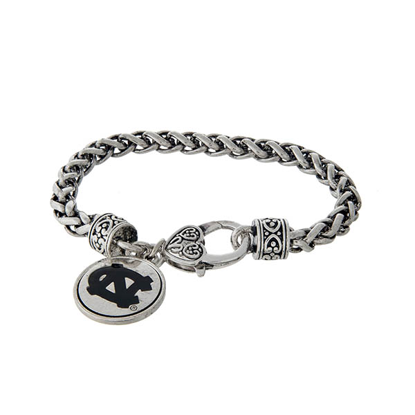 Officially licensed University of North Carolina silver tone braided bracelet with a lobster clasp and logo charm.