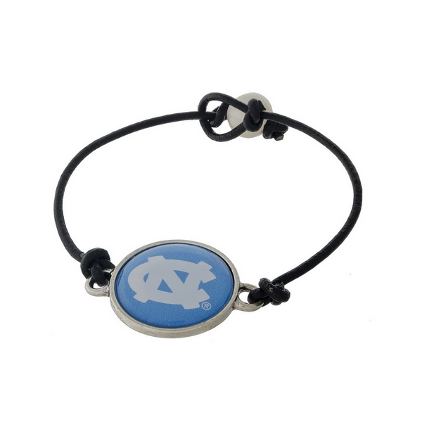 *Our Exclusive Design* Officially licensed University of North Carolina, genuine leather cord bracelet with a freshwater pearl bead closure.