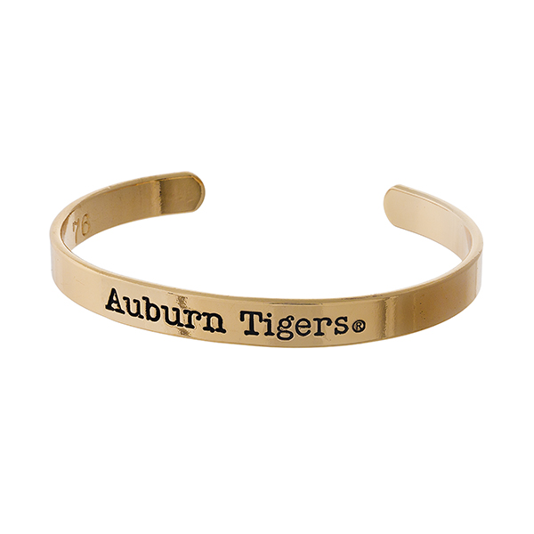 "Officially licensed, Auburn University gold tone cuff bracelet stamped with ""Auburn Tigers."""