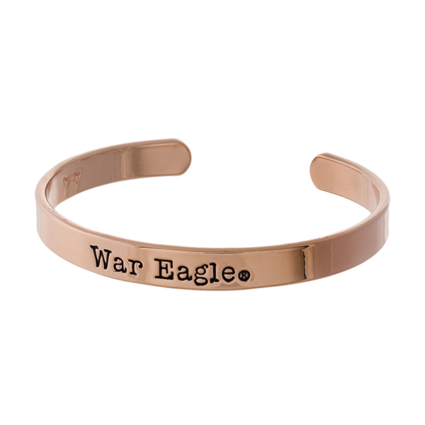 "Officially licensed, Auburn University rose gold tone cuff bracelet stamped with ""War Eagle."""