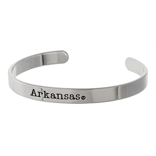 "Officially licensed, University of Arkansas silver tone cuff bracelet stamped with ""Arkansas."""