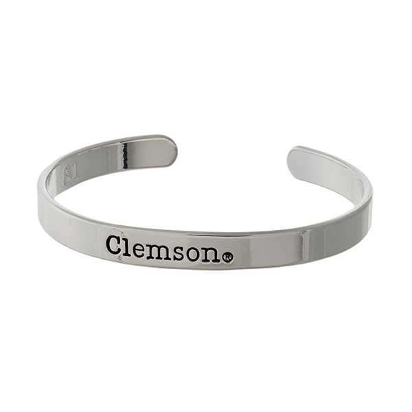 """Officially licensed, Clemson University silver tone cuff bracelet stamped with """"Clemson."""""""
