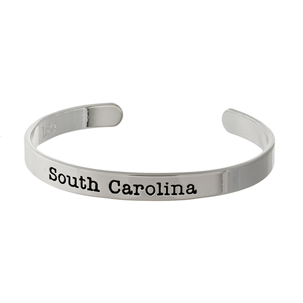 "Officially licensed, University of South Carolina silver tone cuff bracelet stamped with ""South Carolina."""