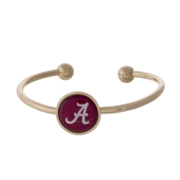Officially licensed, gold tone cuff bracelet with the University of Alabama logo.