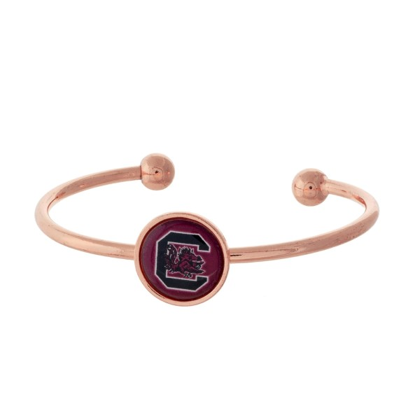 Officially licensed, rose gold tone cuff bracelet with the South Carolina logo.