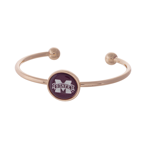 Officially licensed, rose gold tone cuff bracelet with the Mississippi State logo.