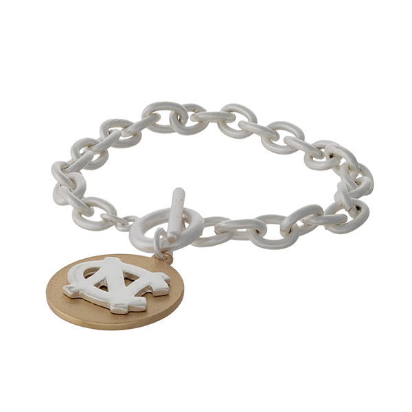 Officially licensed, two tone toggle bracelet with the University of North Carolina logo charm.
