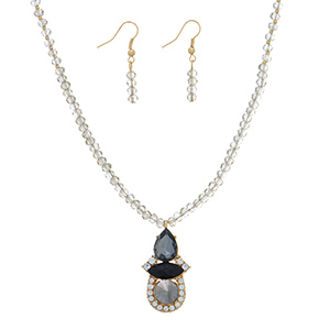 """Gold tone necklace set featuring gray beads with a black and hematite stone pendant with rhinestone accents. Approximately 16"""" in length."""