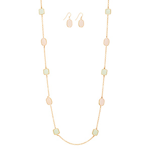 "Gold tone necklace set featuring square mint green stones and oval pale pink stones. Approximately 34"" in length."