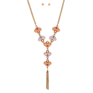 "Burnished gold tone necklace set featuring pink and peach teardrop shaped cabochons with a metal tassel accent. Approximately 19"" in length."