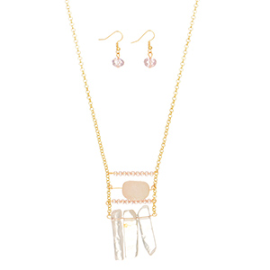 "Gold tone necklace set featuring a round pale pink natural stone with stone fringe decor. Approximately 32"" in length."
