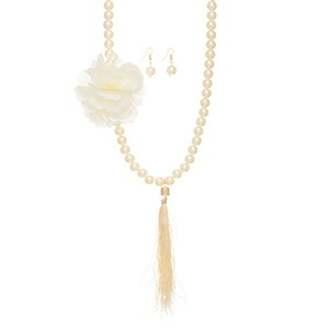 """Cream faux pearl necklace with a large flower and tassel accent. Approximately 50"""" in length.  Can be doubled over into a layered look."""