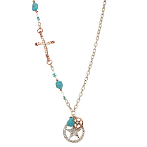"Burnished silver tone necklace featuring turquoise stone with two tone sheriff's star and a copper tone cross. Approximately 21"" in length."