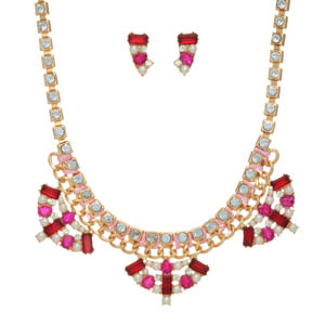 "Gold tone necklace set featuring a rhinestone chain wrapped with pink thread and ruby red and fuchsia cabochons with faux pearl accents. Approximately 16"" in length."