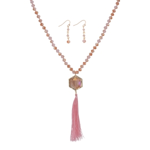 "Pink beaded necklace set featuring a hexagon shaped stone with a hanging tassel. Approximately 33"" in length."