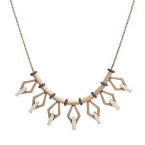 "Worn gold tone necklace featuring a casting with diamond shapes and cream cabochons. Approximately 18"" in length."