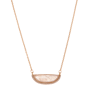 "Gold tone necklace displaying a white semicircle stone with rhinestone accents. Approximately 15"" in length."